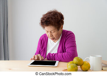 Mature woman working with laptop