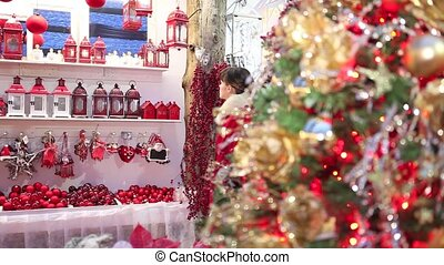 Christmas woman shopping decorations in market store