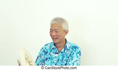 Asian man blue hawaii shirt and hat - Asian senior man...