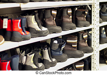 high boots on shelf in store
