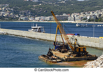 Greece, Kavala, crane dredging in the harbor