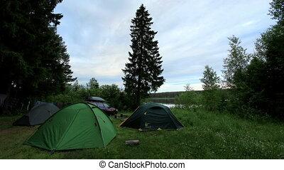 Tourist tents Sunrise on the Votkinskiy pond Votkinsk,...