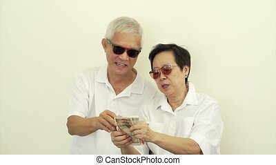 happy rich asian senior cash money