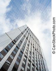 Online business - Worms eye view of office block overlaid...