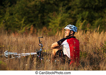 cyclist with bike relax in the sunny autumn park - cyclist...