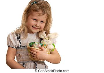 Little girl holding Easter basket