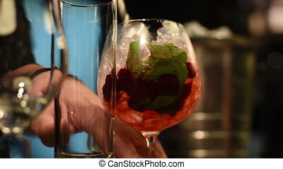 Making cocktail in bar - Closeup photo in a bar where barmen...