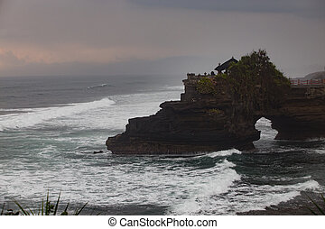 Ocean rock with hole near Pura Batu Bolong temple, Bali,...