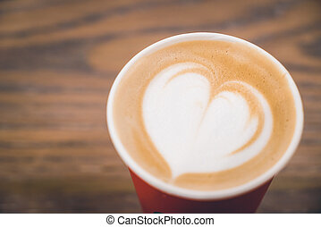 Heart latte coffee in red cup - Soft focus on Heart latte...