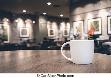White coffee cup in coffee shop cafe - Soft focus on White...