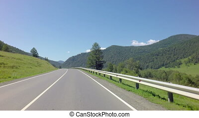 Travel by car on the Chuysky Trakt in Altai Mountains. -...