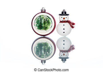 snowglobe with christmas tree inside with snowman on white...