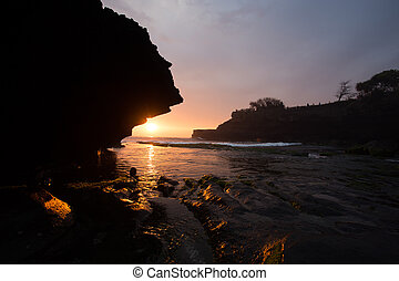 sunset over hindu temple Pura Tanah Lot, Bali, Indonesia