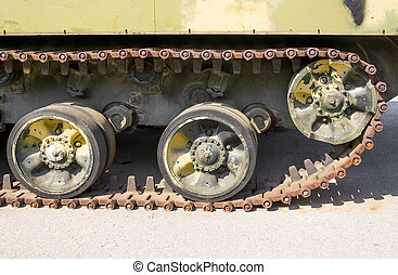 Caterpillar armored vehicles and three wheels Side view
