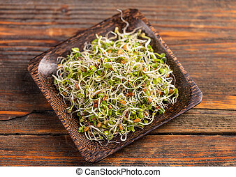 Mix of green young sprouts in bamboo plate