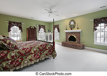 Master bedroom with brick fireplace