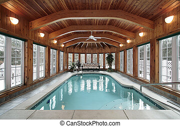 Swimming pool with wood ceiling beams - Swimming pool in...