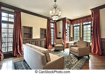 Living room with wood trim - Living room in luxury home with...