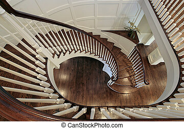 Spiral staircase with wood railing - Spiral staircase in...