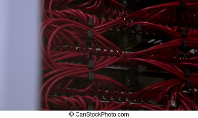Red wires with patch cords on server rack