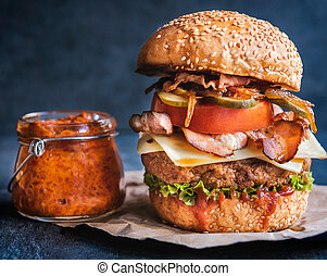 Beef burger and ajvar - Beef burger in the bun with bacon...