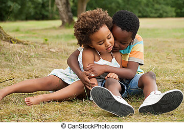 Big brother is caring of his sister - african brother and...