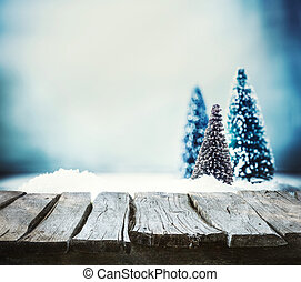 Christmas background. Xmas fir tree on snow. Empty winter...