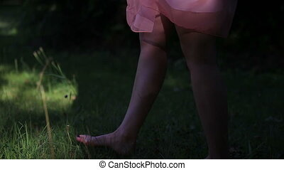 Girl Wearing Light Summer Dress Walking in the Field on Sunny Day Outdoors