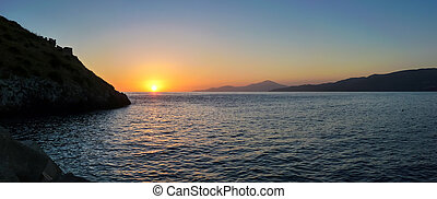 Scenic panoramic view of beautiful idyllic sunset above the sea