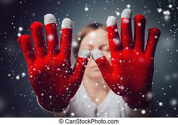 Beautiful woman in Santa Claus costume making Stop hand...