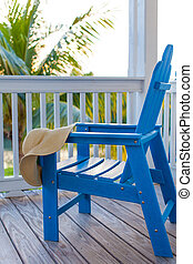 adirondack chair - blue empty adirondack chair with sunhat...