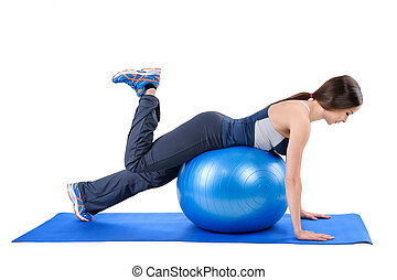 Fitness Stability Ball Glute Kickback - Young woman shows...