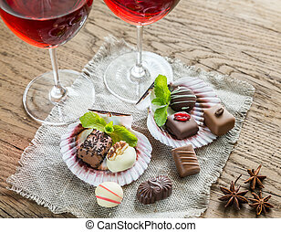 Luxury chocolate candies with two glasses of wine