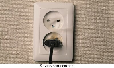 Fire in European style wall socket Concept: house insurance,...