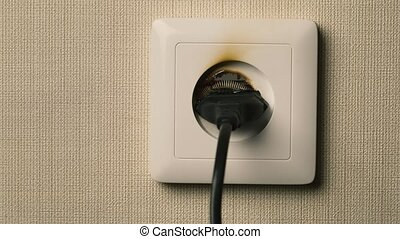 Fire in European style wall socket Real flames