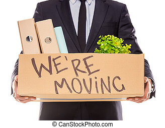 Business moving in office - Young happy businessman with box...
