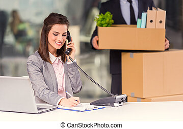 Business moving in office - Young happy businessman and a...