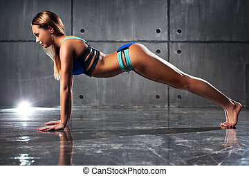 Young sexy fitness woman