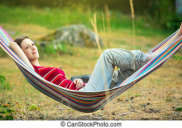 Woman in hammock - Young woman resting in hammock