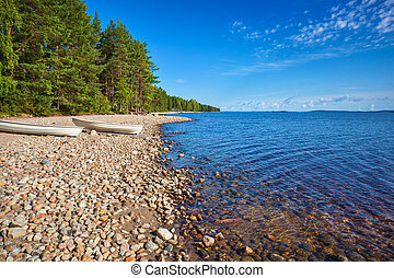 Lake shore with boats Finland morning landscape