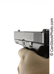 Firearm being aimed with hand in view and angled to see down...