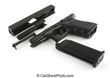 Disassembled firearm - A handgun that has been broken down...