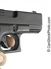 Handgun being aimed with finger on trigger. Gun angled for...