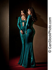 Woman in long turquoise dress - Elegant young woman in...