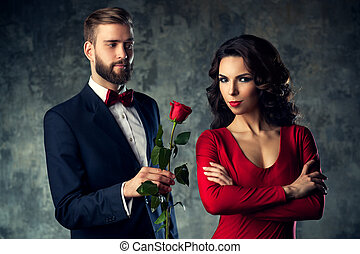 Young elegant couple with rose