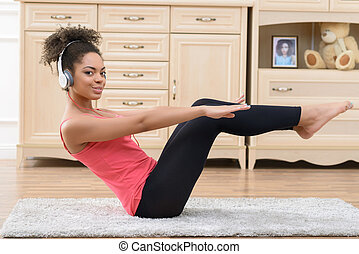 Cheerful girl doing physical exercises - Stay healthy and...