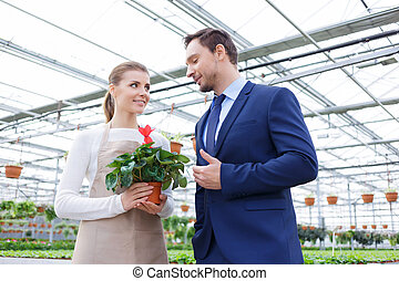 Positive businessman discussing business with his florist -...