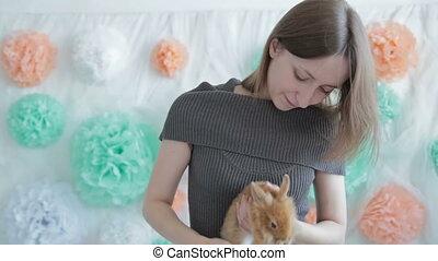 Woman holding little cute rabbit, HD