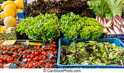 market with various colorful fresh fruits and vegetables. Farmers market. Fresh vegetables on shelf in supermarket