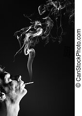 Man Smoking Cigarette - Young adult white Caucasian man...